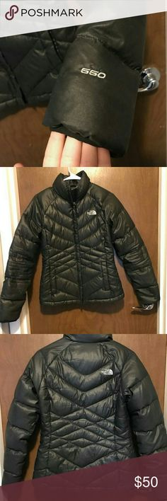 The North Face Aconcagua Coat 550 Black fabric with a sheen. Womens size small, hoodless puffer coat.  GREAT deal.  Light weight feel with serious insulation power. Great in mild or bitter temperatures.  Open to offers. Would like to see this gone as it no longer fits me. The North Face Jackets & Coats Puffers