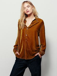 Velvet Henley Pullover | In an oversized, slouchy fit, this henley style velvet pullover features buttondown detailing on the placket.  Subtle high low rounded hem.  American made.