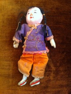 My ancient Chinese doll. Costume colors are vibrant with meticulous embroidery.