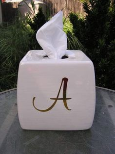 Monogramed Glazed Tissue Box Cover Gold Letters by whitedovecrafts on Etsy   Elegance divine for your bathroom, bedroom or even your desk at work.  Adds a little touch of class to any spot it is placed in.