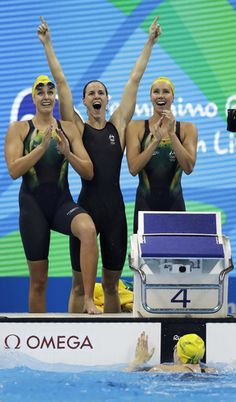 Swimming's best sister act carries the Aussies to relay gold  -  Australia's Emma McKeon, Brittany Elmslie and Bronte Campbell celebrate as Cate Campbell, bottom, finishes the women's 4x100-meter freestyle final setting a new world record during the swimming competitions at the 2016 Summer Olympics, Saturday, Aug. 6, 2016, in Rio de Janeiro, Brazil. (AP Photo/Michael Sohn)