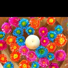 Mexican party ideas! We did these little flower vases for a mexican party we're having! A little white candle is in the middle!