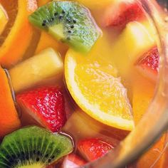 Tropical White Wine Sangria combines sweet white wine with tropical fruits and fruit juices! Perfect sangria recipe for summer - it's like a mini vacation in a glass! Tropical Sangria Recipe, Blackberry Sangria, Sangria Drink, White Wine Sangria, Summer Sangria, Sangria Recipes, Wine Drinks, Summer Drinks, Apple Sangria