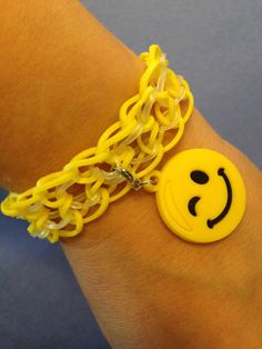 a dragon scale bracelet with smiley face charm. #loom #bands #jewelry