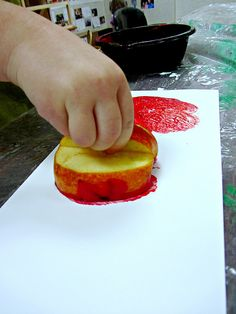 apple prints with a handle for mess-free art! brilliant. // teaching two and three year olds.