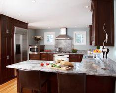 Walnut cabinets with super white granite countertops