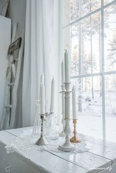 white wood, candles and white snow