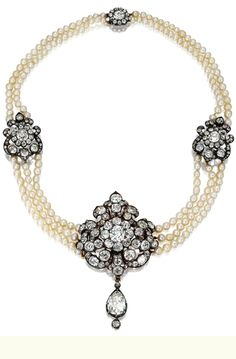 DIAMOND AND PEARL CHOKER-NECKLACE, CIRCA 1880 The center decorated with a floral and foliate cartouche set with old-mine diamonds, anchored by a pear-shaped diamond pendant, the sides decorated with smaller ornaments of similar design, joining three rows of baroque pearls measuring approximately 3.5 to 4.0 mm., the necklace back composed of two rows of pearls completed by a diamond-set floral clasp, the whole set with 207 old-mine and rose-cut diamonds weighing approximately 18.25 carats