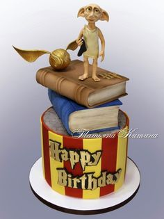 Splendid Dobby Cake This wonderful Harry Potter cake was made by Tatyana Kitina The bottom tier of the cake has scarlet Dobby Harry Potter, Gateau Harry Potter, Cumpleaños Harry Potter, Harry Potter Birthday Cake, Harry Birthday, Harry Potter Images, Happy Birthday Girls, Cakes For Boys, Cute Cakes