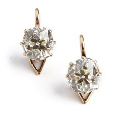 fdfedd611f2 Jewellery, a pair of Belle Epoque diamond ear pendants each set with an old-cut  diamond weighing a total of app., mounted in gold.