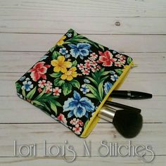 Bold floral zipper pouch with bright yellow lining.  Approximately 7x9 inches.