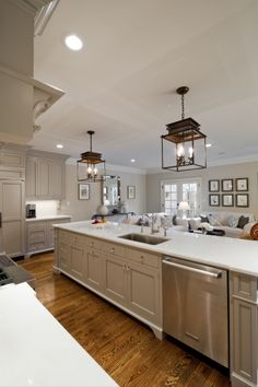 I love the lights and the simple cabinets style with the furniture bottom detail