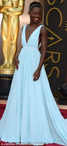 Glam in the rain! Nominee Lupita Nyong'o were fashion triumphs in Prada on the red carpet at the Oscars in Hollywood on Sunday