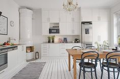 Kitchen as the center of the home - via cocolapinedesign.com
