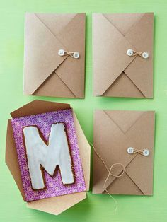 To package, cut scrapbook paper to fit the interior of a petal envelope and adhere with double-sided tape. Use glue dots to attach buttons to the flap and 1/2 inch from the opposite fold. Wrap twine in a figure 8 around the buttons to close