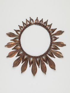 Kinda folksy yet modern. Sher Novak, BFA. Autumn Leaves, 2015, Necklace, Patinated copper, leather cord, 10.5 x 10 inches.