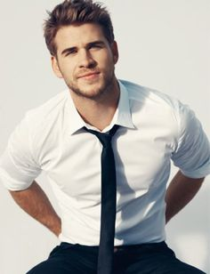 Liam Hemsworth...he's usually not the type I would be attracted to but I can appreciate a good looking man when i see him :)
