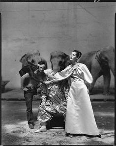 Dovima wearing Givenchy with Emilien Bougleone and a clown. Richard Avedon.