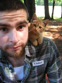 Wait.... a collection of photographs of cute guys with beards... with KITTIES! Swoon... sigh... ok I don't know if I can be productive today...