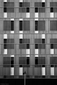 Irregular grid patterns in architecture with contrasting lines, tone & texture