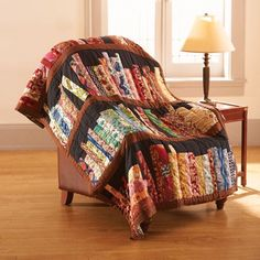 There is nothing better than getting cozy under your favorite blanket with a good book. That's why when we say this library book quilt, we HAD TO HAVE IT! with each book an individual quilt piece it truly is one of a kind to add to your reading corner. Quilted Throw Blanket, Throw Blankets, Book Quilt, Book Lovers Gifts, Book Gifts, Library Books, Library Ideas, My New Room, My Living Room