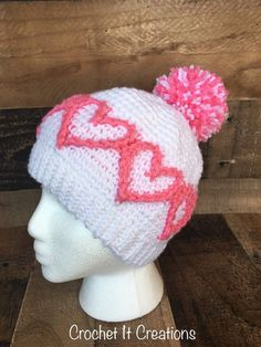 The Heart to Heart Beanie crochet pattern by Crochet It Creations is a cute hat with textured hearts.