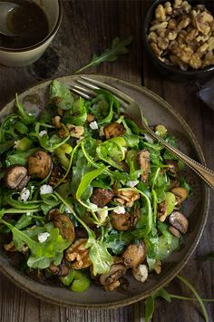 Mushroom and arugula salad - crunchy celery, soft goat cheese, and toasted walnuts, tossed in shallot mustard vinaigrette.