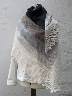 The Transition Stash-buster shawl began as I looked at several left-over bits and odd ends of yarn that happened to have the same colours. I then raided the stash to find other yarns that would fit, and in the end, I had a good selection. Free pattern