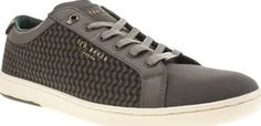 Ted Baker Grey Kerran 3 Mens Trainers If youre going to go casual this season then do it the Ted Baker way. The Kerran 3 arrives in grey fabric with decorative side panels for a slick look. Leather detailing and gold branding create a pre http://www.comparestoreprices.co.uk/january-2017-8/ted-baker-grey-kerran-3-mens-trainers.asp