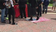 Air Force vet Michelle Manhart protectes American flag from protesters