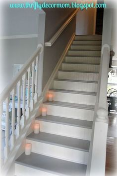 Our stairs were covered with old, worn out carpet that had definitely seen better days. We removed the carpet and used paint and beadboard to give the stairs a… Painted Staircases, Painted Stairs, Spiral Staircases, Painting Wooden Stairs, Redo Stairs, Basement Stairs, Hardwood Stairs, White Stairs, Staircase Remodel