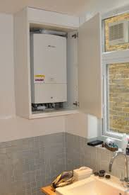What do you do with boiler and gas meter in a garage for Kitchen boiler cupboard