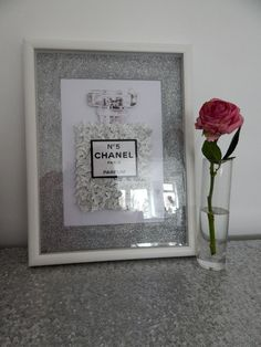 A personal favourite from my Etsy shop https://www.etsy.com/uk/listing/269143079/chanel-no-5-3d-butterfly-picture-with