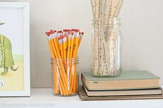 pencils and rulers in mason jars
