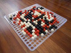 The gigantic 19x19 Shibumi set (50 cm side, laser-cut acrylic board, one inch phenolic resin balls).