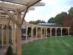 I have just finished making a large oak pergola. It's about long and consists of 16 bays. All of the beams running along the pergola, and joists running across it have a lovely gentle cur… Wisteria Pergola, Curved Pergola, Retractable Pergola, Pergola Garden, Pergola Attached To House, Pergola With Roof, Covered Pergola, Garden Trellis, Pergola Shade