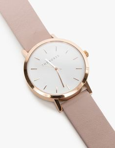 From the Horse, a simple oversized minimalist watch with a clean-lined dial and rose gold markers. Features a blush tone vegetable tanned leather band that will patina over time. • Oversized minimalist wrist watch • Italian leather details and linin