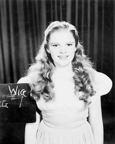 """Judy Garland as Dorothy Gale in """"The Wizard of Oz"""" (1939), make-up and costume test, with rejected dress and blonde wig."""