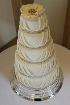 Pleated 5 Tier Wedding Cake 5 tiers including lemon cake filled with lemon butter cream, vanilla cake with raspberry coulis, wheat free. Gorgeous Cakes, Amazing Cakes, Pleated Cakes, Lemon Cake Filling, Round Wedding Cakes, Cupcake Cakes, Cupcakes, Cupcake Ideas, Fancy Cakes
