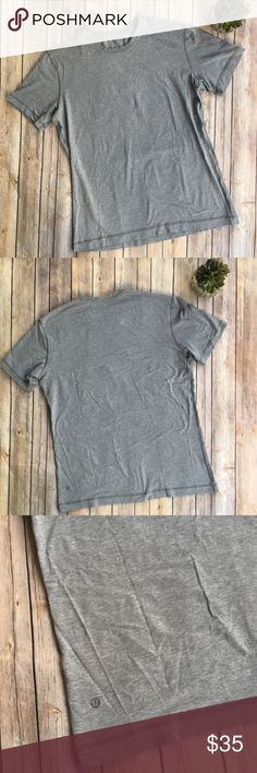 Lululemon grey basic tee Sooo soft! Worn once. Tag was cut out. I think it's a medium. But see measurements for reference. lululemon athletica Shirts Tees - Short Sleeve