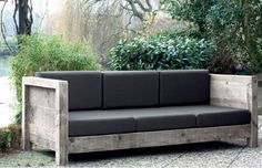 Garden sofa from recycled scaffolding boards