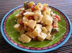 Een heerlijke aardappelsalade die  bomvol smaak zit door de toevoeging van diverse groenten.