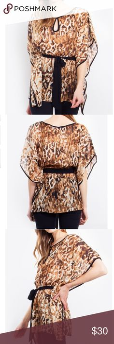 In the Wild Top Chiffon leopard print kaftan top. Features black piping , a keyhole opening, and black sash to cinch in the waist . Can also be worn on the beach as a coverup . 100% polyester. Boutique Tops