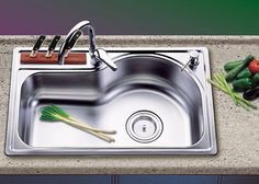 Google Image Result for http://www.powellconstruction.com/blog/wp-content/uploads/2012/05/stainless-steel-kitchen-sink-picture1.jpg