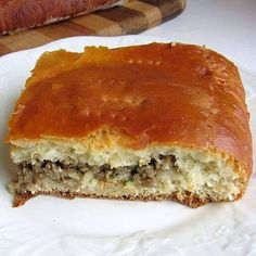 slice of a meat-filled pyrih, from about.com Eastern European foods. They also have the recipe for pyrohy (as opposed to varenyky) at http://easteuropeanfood.about.com/od/ukrainiansnoodlesetc/r/pyrohy-dough.htm