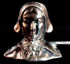 This is a silver plated candle Snuffer in the Priscilla Alden or Pilgrim Head pattern. Looks to be a product of the 1920s during the Colonial Revival period. It is marked J.B. 267. It is silverplate.