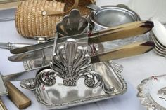 silver knife holder for a buffet