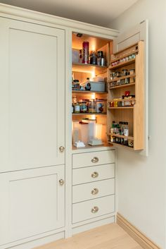 This beautiful Oak larder cupboard & spice rack has integrated lighting. A lovely touch as you open the door for your favourite spices and ingredients. Kitchen Cabinet Makers, Tall Kitchen Cabinets, Kitchen Drawers, Kitchen Cabinet Design, Kitchen Storage, Tall Cabinet Storage, Larder Cupboard, Integrated Fridge, Cabinet Lighting