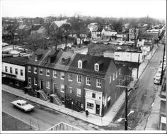 Calvert Street at Clay Street in 1964.  This is where the Whitmore Garage and park is located.