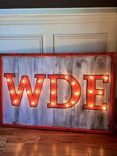 Lighted marquee sign with WDE in orange and by hootenannyauburn